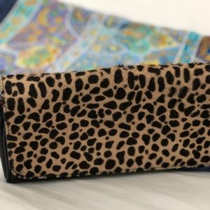 Animal print leather clutch with strap